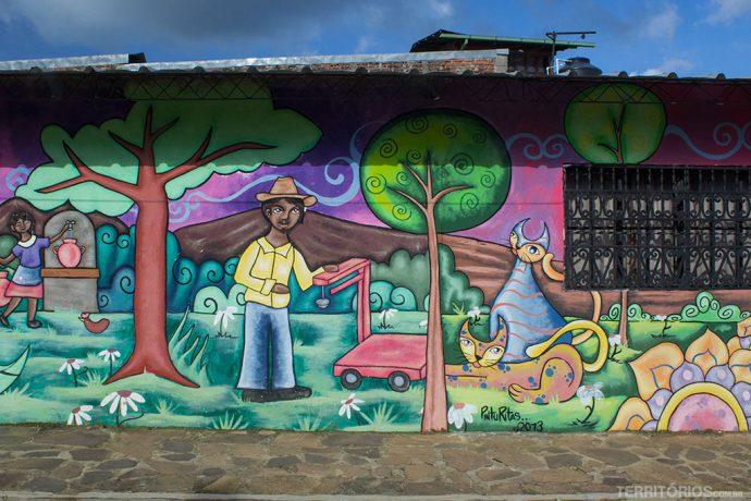 Cotidiano dos moradores ilustrados nas fachadas das casas